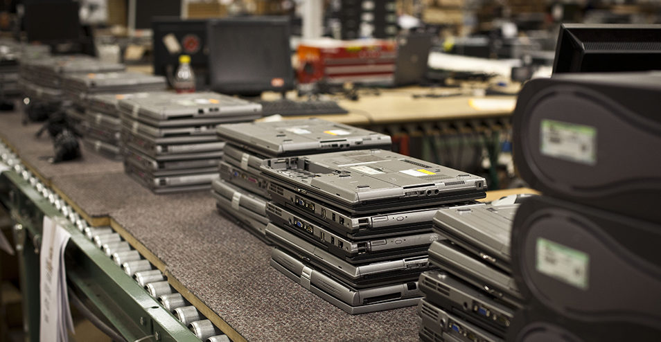 Stacks of returned laptops in audit